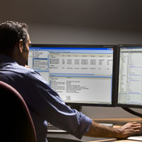 SmartSystems Operator working on computer